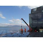 Picture of The mini-cranes Unic execute in Iceland works of elevation �in perfect harmony'