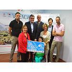 Picture of Grupo Guzm�n entrega el cheque solidario de Ekiden a Avapace