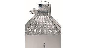Foto de La nueva termoformadora Multivac R 685 procesa l�minas muy anchas para un gran volumen de mercanc�a ya cortada