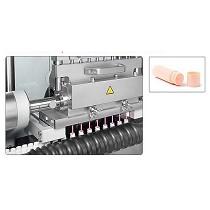 Monobloc autom�tico para el tratamiento de b�lsamos labiales