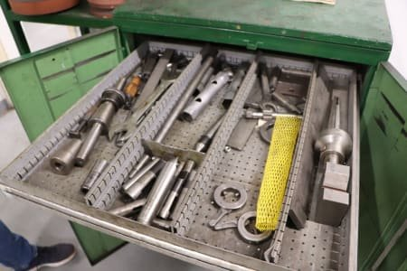 Cabinet with grinding accessories and measuring equipment