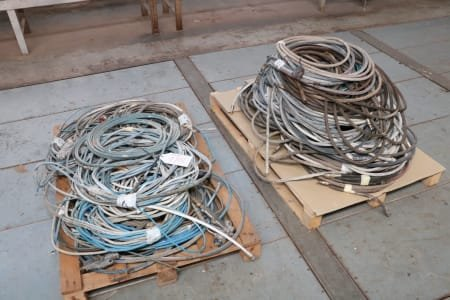 Lot of paint guns and hoses