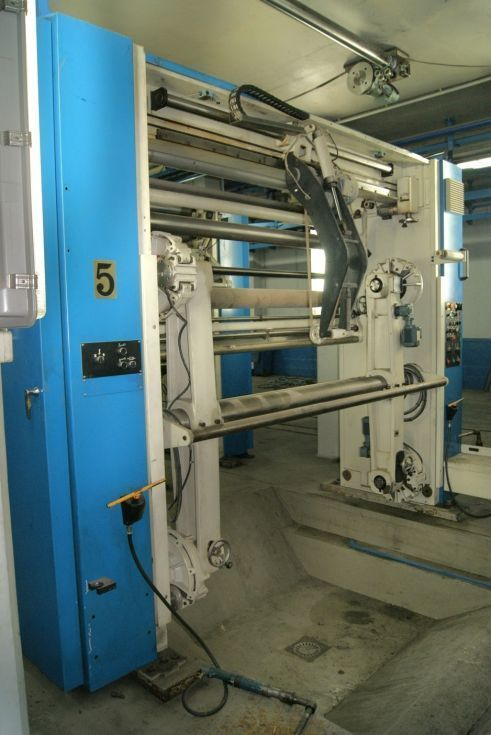 Porta bobinas automático