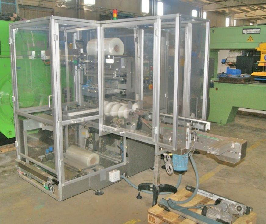 Empaquetado de cosmeticos / Shrink wrapping machine