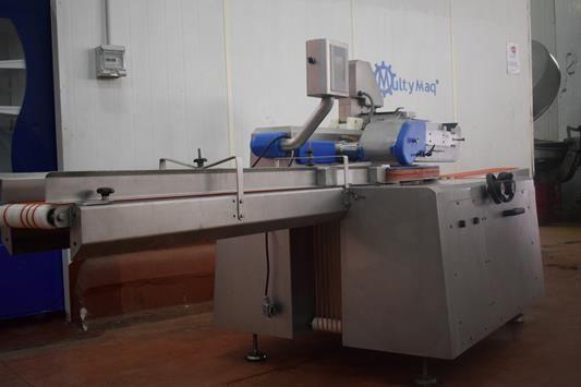 Maquina para posicionar salchichas