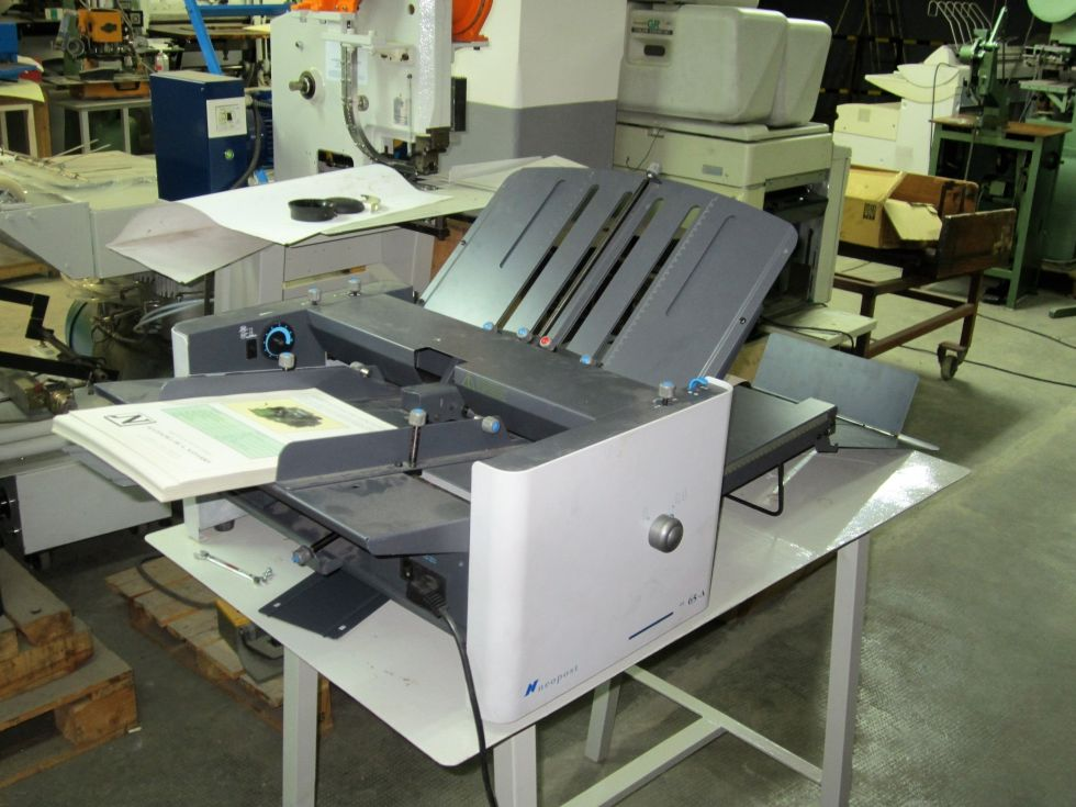 Plegadora de papel por fricción