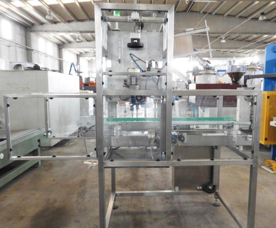 Máquina automática para la aplicación de asas adhesiva
