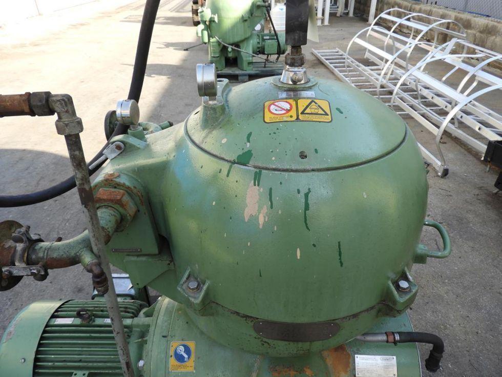 Centrifuga de disco autolimpiante