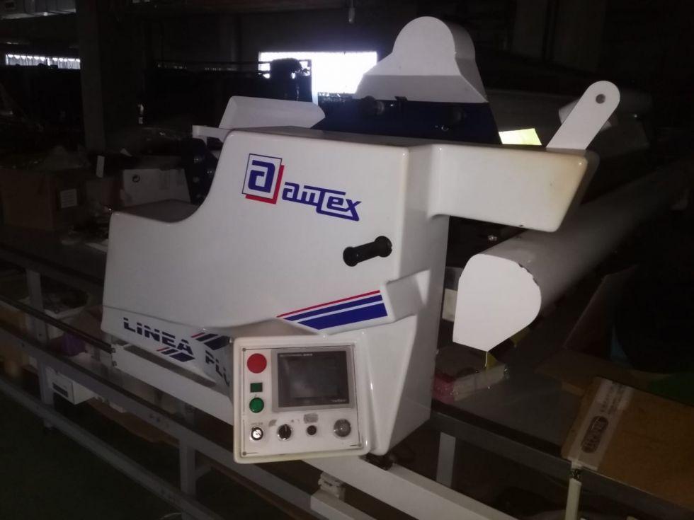 Máquina extendedora textil