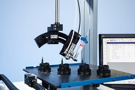 Sistema de dosificación automática de la Serie R con 4 ejes y repetibilidad superior