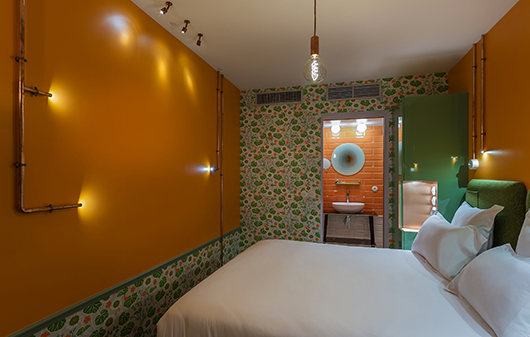 interior designer julie gauthron collaborates with street artists to give hotel exquis a vibrant. Black Bedroom Furniture Sets. Home Design Ideas